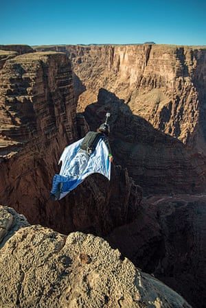 BASE jumping in Utah: A parachutist wearing a wingsuit dives from the cliff edge