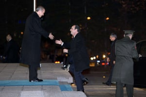 French president Francois Hollande (C) is welcomed by Turkish Prime Minister Recep Tayyip Erdogan, on January 27, 2014, in Ankara, as part of a two-day state visit in Turkey.