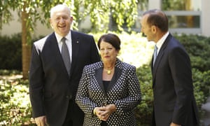 Former Defence Force chief, General Peter Cosgrove poses for photographers with his wife Lynne and Prime Minister Tony Abbott after being announced as the next Governor General on January 28, 2014 in Canberra, Australia. General Cosgrove will replace Quentin Bryce in March becoming the 26th Governor General of Australia. As former Defence chief, Cosgrove commanded troops in East Timor and was named Australian of the Year in 2001.