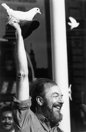 Pete Seeger: Seeger holds up a dove on his hat at a Times Square anti-Vietnam War rally