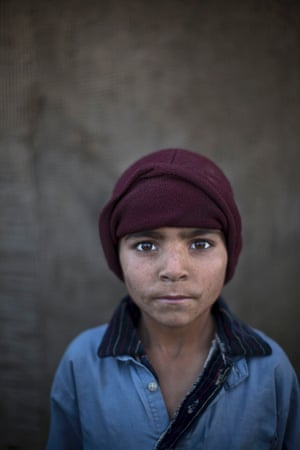 Afghan refugee Noorkhan Zahir, six, poses for a picture while playing with other children in a slum on the outskirts of Islamabad, Pakistan.