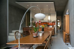 Homes - Concrete house: wooden table in dining area with grey walls