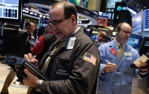 Trader Edward Landi, left, on the floor of the New York Stock Exchange as stocks head higher after three days of losses. Photo: AP Photo/Richard Drew