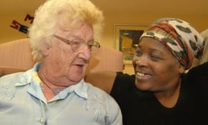 care worker chats to older woman
