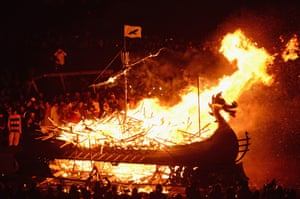 The Jarl Squad march around a Viking Longship before torching it on January 28, 2014, in the Shetland Islands, Scotland.