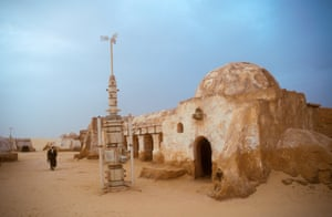 An Arab man walks in the remains of the Star Wars set now a tourist attraction in the desert Tunisia