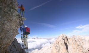 The Italian Dolomites have a huge array of nervewracking mountain routes. Dubbed the Via Ferratas, or Iron Ways, the paths were first built by troops during the first world war, but many more have been extended and upgraded since then. Here two climbers are pictured ascending a ladder on the Cristallo peak.