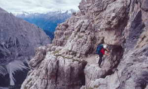 Although the Via Ferrata in the Dolomites can be hiked safely and are a popular attraction, you will still nead a head for height and a steady foot to handle traversing the many sheer cliff edges. This climber is tackling the via ferrata on the Brenta Dolomites.