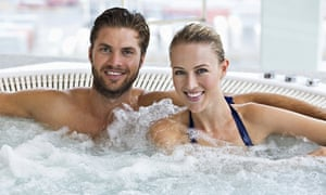 smiling couple in hot tub