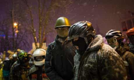 Anti-government protestors in various helmets gather in Independence Square in Kiev, Ukraine. Ukraine's parliament is holding a special session called over continuing unrest in the country and Prime Minister Mykola Azarov has offered to resign.