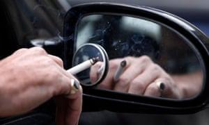 Man smokes in car