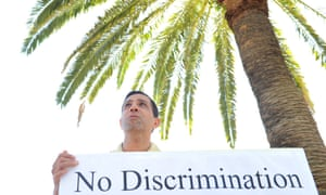 A refugee takes part in a protest outside the office of the immigration minister, Scott Morrison, in Sydney