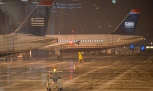 Airport staff work at the Reagan National Airport in Washington DC, capital of the United States, 2 January, 2014