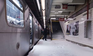 Snow makes it way down to the platform of the 65th Street subway station during a winter storm in New York, 3 January, 2014
