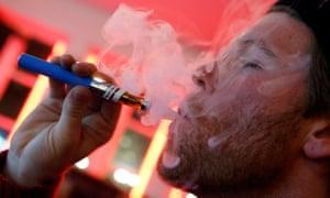 A customer puffs on an e-cigarette at the Henley Vaporium in New York City