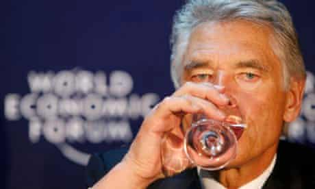CEO of Nestle Peter Brabeck-Letmathe drinks water during a news conference at the WEF in Davos