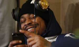 Marshawn Lynch #24 of the Seattle Seahawks briefly removes his headphones ahead of Super Bowl XLVIII
