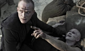PRIEST: Paul Bettany fights vampires