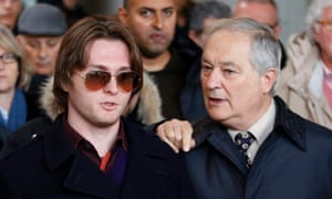 Raffaele Sollecito, left, talks to his father Francesco as they leave the Florence courtroom earlier today.