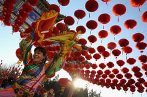 Chinese folk artists perform at the Temple of Earth park in Beijing