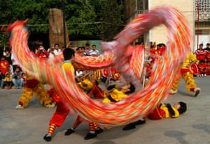 Chinese Cambodian men perform a dragon dance at the Chinese Embassy in Phnom Penh.