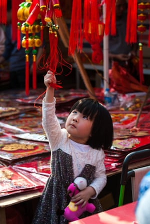 A little girl enjoys the flower fair in Shenzhen in China's Guangdong Province.