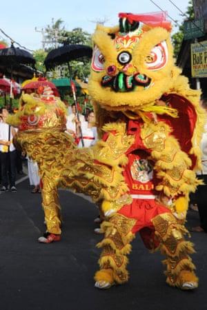 A dragon dance parade in Kuta, Bali.