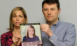 Kate and Gerry McCann with a missing person poster for their daughter Madeleine.