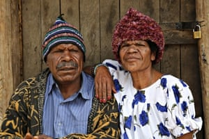 Rose James and husband outside their hut in Namasaro, Papua New Guinea