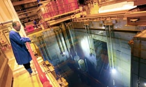 A Sellafield employee watches barrels containing radioactive nuclear waste