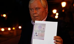 Lawyer Anatoly Kucherena with a picture of Snowden's new refugee documents, August 1, 2013.