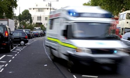 An ambulance rushes to an emergency