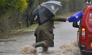 Angry resident hits vehicle driving through floodwater