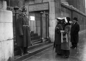 Before the war: Visitors reading a sign outside the National Gallery in 1914