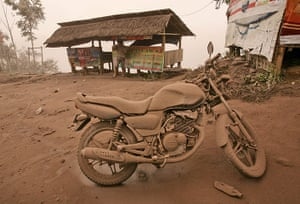 Mount Sinabung: A motorcycle is covered in volcanic ash