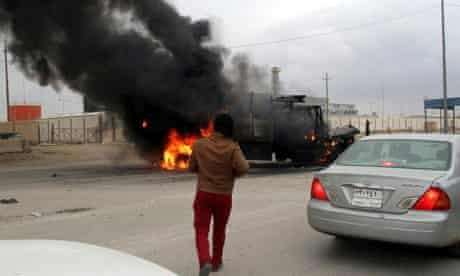 A vehicle on fire in Anbar province, Iraq, in clashes between militants and Iraqi security forces