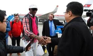 Dennis Rodman shakes hands with North Korea's sports vice-minister Son Kwang-ho at Pyongyang airport
