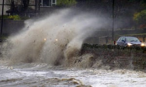 Strong winds and high tides batter the coastal road close to Newtownards, Northern Ireland. The Met Office has issued a yellow warning for rain, and flooding is expected in parts of Belfast and along the east coast of the country because of a tidal surge, combined with strong winds.