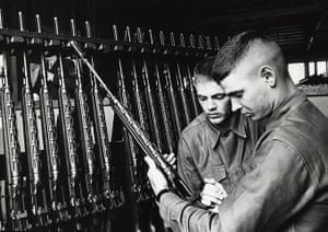 Phil Everly: Phil watches Don take his rifle from the rack during their Army service