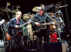 Phil Everly: Paul Simon and Phil Everly. The Everly Brothers joined  Simon and Garfunkel