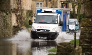 A delivery truck driver steers his vehicle along a flooded road in the village of Silton, near Oxford, England on January 6, 2014.  Flood warnings remained in place in many parts of Britain as huge waves began battering the southern coast.