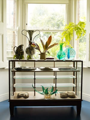 Homes - Hollicks House: Glass cabinet in house with vases on top