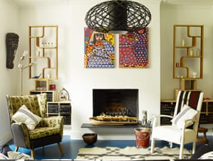 Homes - Hollicks House: Armchairs in living room with open fireplace and shelving units