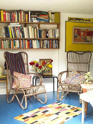 Homes - Hollicks House: chairs in living/dining room with bookshelves on walls