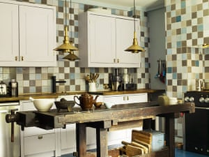 Homes - Hollicks House: Kitchen with multi-coloured tiles and wooden table