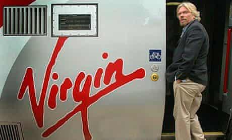 Sir Richard Branson boarding a Virgin train