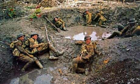 Soldiers in muddy, flooded shell holes in scene from the 1969 film Oh What a Lovely War
