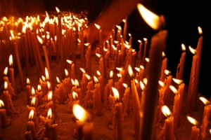 The candles are seen at the Serbian Orthodox church during the liturgy.