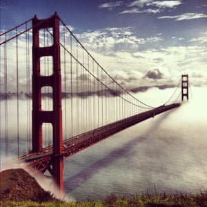 Golden Gate bridge taken from a popular tourist spot just north of the bridge on a rare day of low-rolling fog (iPhone 4)