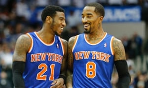 New York Knicks guards JR Smith and Iman Shumpert share a joke in Dallas.